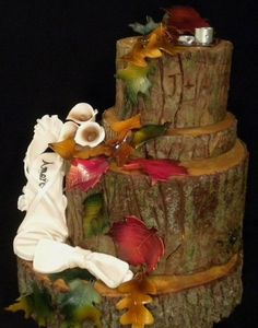 Beautiful fall wedding cake - the top 3 tiers are REAL cake to look like logs stacked. The bottom is real wood. On this cake you will find a gumpaste Stiletto, gumpaste bow tie, gumpaste fall leaves, and gumpaste wedding rings. Wedding Cake Pops, Wedding Cake Rustic, Fall Wedding Cakes, Wedding Cake Decorations, Beautiful Wedding Cakes, Wedding Art, Beautiful Cakes, Trendy Wedding, Amazing Cakes