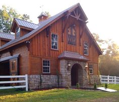 This barn is absolutely incredible! My horses would live like kings and queens tucked away in their little palace. :D: