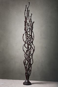 Made of recycled railroad spikes, this sculpture by Phoenix sculptor Kevin Caron has a linseed oil finish.