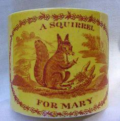 Early 19th century English yellow glaze child's mug.
