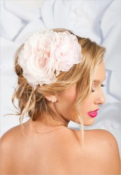 A large flower embellishment perched on an updo can be the perfect #wedding hairstyle. Find your best hair makeover here: http://www.esalon.com/blog/7-no-risk-hair-makeovers/