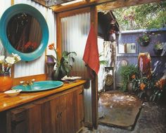 outdoor shower connected to boho bathroom