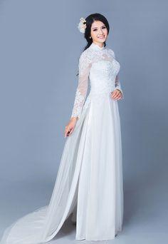 Áo dài cưới cách tân 2015 được thiết kế cầu kỳ với phần đuôi dài thướt tha lấy cảm hứng từ váy cưới.