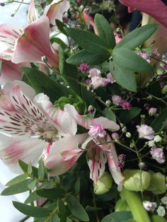 Beth's wedding flowers. Beautiful, rustic, teapots!