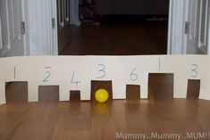 tunnel maths game - roll the balls through the tunnels and add up as you go