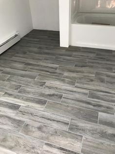 wood look tile floor Lifeproof shadow wood porcelain tile with delorian gray pro grout from HD Ceramic Wood Tile Floor, Wood Look Tile Floor, Grey Wood Tile, Grey Floor Tiles, Wood Tile Floors, Grey Flooring, Porcelain Tile, Gray Hardwood Floors, Flooring Ideas
