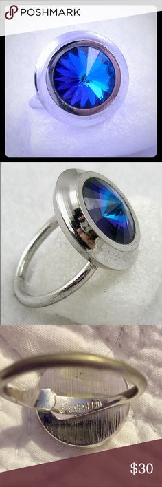 """💍VINTAGE Sarah Coventry Ring💍 A beautiful Vintage Sarah Coventry ring from 1971. The design was called """"Liquid Lights"""". A silver plated adjustable ring set with a large blue rivoli stone, flashes of purple and shades of deep blue and teal can be seen in the stone. Signed """"©Sarah Cov"""" on the inside of the band.   Adjustable up to about a size 8 (3/4"""" dia.) Sarah Coventry Jewelry Rings"""