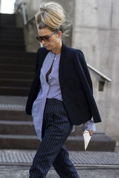 Give your classic striped button-up an upgrade by pairing it with some contrasting striped trousers. #refinery29 http://www.refinery29.com/2016/05/111596/sydney-fashion-week-resort-2016-street-style-pictures#slide-4