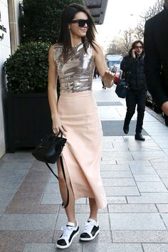 Who: Kendall Jenner What: Futurism and a Pair of Kicks Why: The model hits the streets of Paris in a futuristic Mugler dress, pared down with black and white sneakers.  Get the look now: adidas sneakers, $80, adidas.com.   - HarpersBAZAAR.com