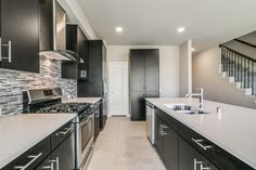 Looking for a sleek, modern vibe to your kitchen? Even with black cabinets, this kitchen still looks bright! Kitchen Cabinets Pictures, Custom Kitchen Cabinets, Bloomfield Homes, Reclaimed Wood Kitchen, Wood Kitchen Island, Traditional Cabinets, Western Kitchen, New Kitchen Designs, New Home Builders