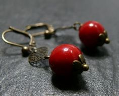 Boucle d'oreille Priere Tibetaine Rouge €14.00