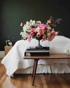 I've been talking about my love for dark green walls a lot lately and this pic by @frenchbydesign is proving my point. The flowers by @tulipinadesign are sending me over the edge.  {color is Marquee Alpine Green by @behrpaint}