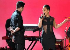 Adam Levine of Maroon 5 and Alicia Keys perform 'Girl On Fire'.