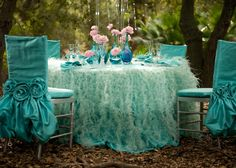 Turquoise Feathers + Light Pink Flowers = Table Magic. It's called math for creative people.