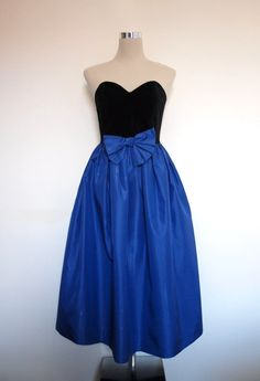 20% sale - 1980s black velvet and blue vintage strapless evening dress / prom dress / ball gown / Holiday party dress. $58.00, via Etsy.