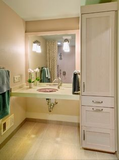 cute and cozy wheelchair accessible bathroom not a fan of the pipes showing under the vanity - Ada Bathroom Design