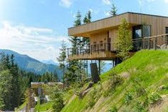 """Completed in 2013 in Austria. Set within the scenic mountain panorama of upper Styria, Austria, the """"Deluxe Mountain Chalets"""" serve as an extension to the numerously awarded high-. Hillside House, Mountain Homes, Small Apartments, Interior Architecture, House Plans, Pergola, New Homes, Outdoor Structures, House Styles"""