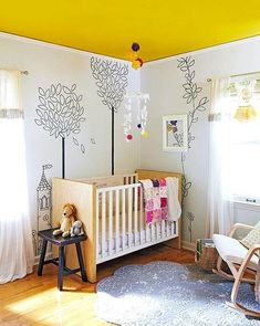 Let your little one's imagination run wild with a fun wall print and bright colors. The black-and-white baby nursery mural amps up boring white walls to pair with a bold yellow ceiling. A cloud-shape rug keeps the room's imagination alive. Ceiling Paint Colors, Yellow Paint Colors, Room Paint Colors, Paint Colors For Living Room, Yellow Painting, Living Room Grey, Living Rooms, Gray Color, Ceiling Paint Design