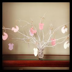 Baby shower Wishing Tree. Have the guests write a wish for the baby or piece of advice for the parents. After the shower put them in a keepsake book.