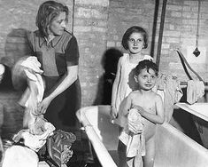 Children liberated from Bergen-Belsen take the first bath they've had in months