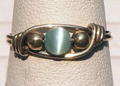 Sterling Silver Wire Wrapped Ring with Light Blue Cat's Eye