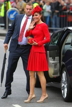 Kate wears a flaming red Alexander McQueen pleated outfit at the The   Queen's Diamond Jubilee River Pageant. The Duchess finished her look with a custom hat by Sylvia Fletcher at James Lock & Co. McQueen is a go-to label for   Middleton, who wore a memorable Sarah Burton for Alexander McQueen lace   gown at her wedding to Prince William last year. It's nice to see the   Duchess wear bright colours!