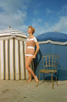 Model on the beach at Deauville, France, 1957. Photo by Mark Shaw.