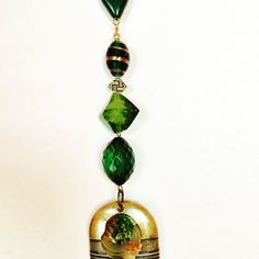 Emerald green and gold repurposed jewelry and bead ornament and sun catcher, a sparkling window and yard decoration!