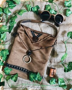 Boho details. #woodsunglasses #gypsyfashion #gypsyaccessories #mininotebooknecklace #mininotebook #bohoslingbag #slingbag #bohochic #summerfashion #tropicalfashion