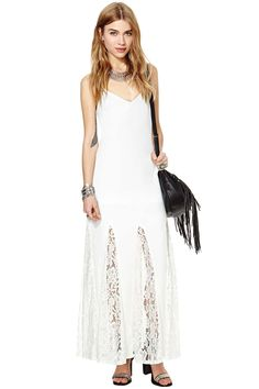 We all know long white dresses can make your wardrobe just a little more epic! This amazing one f...