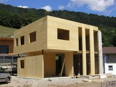 Cross Laminated Timber (CLT) house. Like the three full height windows, and the overhang. Looks very neat and simple to construct.