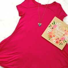 Fuchsia Tee Dress Perfect with sandals, espadrilles or your favorite Keds, this dress is sure to become a favorite! Toss in on and be out the door for summer fun! Slight shark hem, a little longer on the sides than the front and back. Runs true to size, Small shown on 6-8 dress form. ChicBirdie Dresses