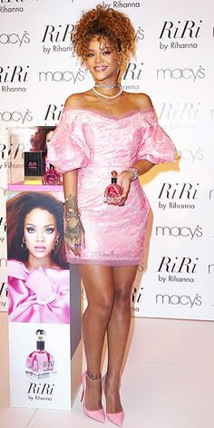 RIHANNA in an off-the-shoulder Vivienne Westwood mini, bubblegum pink Christian Louboutin pumps and a Mikimoto pearl necklace at an unveiling of her new fragrance RiRi by Rihanna in N.Y.C.