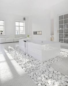 White rocks provide great texture around this bathtub, and also serves a dual purpose of absorbing water after a great, warm dip!