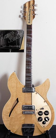 John Frusciante Collection's - Early-'60s Rickenbacker 365 Deluxe in Mapleglo finish formerly owned by James Burton with custom engraved tailpiece.