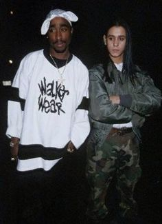 Don't know if this is spliced together, but it's still a good picture of Tupac.  His expression.