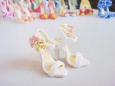 Miniature High Heel Shoes  Handmade from Polymer Clay door YinyingO ♥ just look at all of the teeny tiny shoes in the background! :D