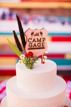 summer camp themed wedding cake, photo by Acqua Photo http://ruffledblog.com/san-clemente-summer-camp-wedding #weddingcake #cakes #summercamp