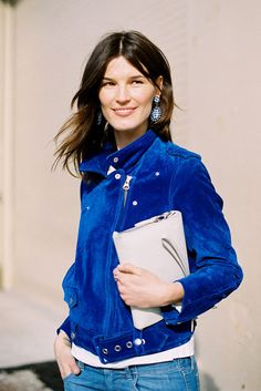 Hanneli  during NY fashion week in Acne motorcyle jacket (amazing, amazing colour) and adorable Miu Miu gingham earrings at Jason Wu.
