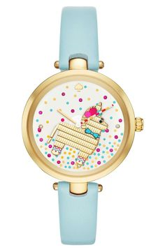 A stately elephant saunters across the minimalist mother-of-pearl dial of this classic round watch by Kate Spade.