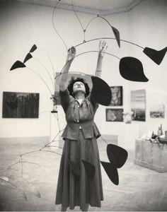 midcenturymoddesign: Peggy Guggenheim with an Alexander Calder mobile (Source: julianminima)