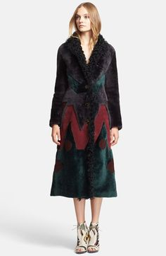 Free shipping and returns on Burberry Prorsum Geometric Pattern Genuine Shearling Coat at Nordstrom.com. A contrasting contoured waist, wide suede zigzags and nubby geometric insets offer bold, geometric dimension in this velvety soft shearling coat from Burberry Prorsum. Curly fur lavishly lines the shawl collar and front placket, furthering the luxe style's warm and cozy aesthetic.