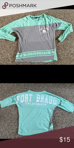 Fort Bragg California shirt super PRICE DROP Sea foam green and grey 3/4 tee with white lettering. In great condition, the lettering has started to wear on the top, the the back of the shirt but hey it's personality as far as I'm concerned.. Shirt quality is great still. No problems or stains. Tops Tees - Short Sleeve