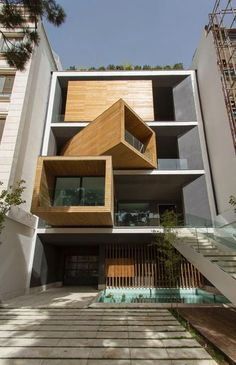 The delightful, surprising design of the Sharifi-ha House by Tehran-based architecture firm Next Office centers around its rotating box-shaped rooms on three floors. The motorized rooms can each be turned 90 degrees to make them outward- or inward-facing according to the weather. The angles at which the boxes are pivoted...