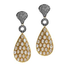 """Kanupriya Shannon Earrings  This bling has bling! Be ready for your black tie event or New Year's Eve. The top piece of these earrings are pave crystals set in oxidized metal with a small crystal ring that links to a a large teardrop dangle with embedded crystals.  - White diamond crystals, oxidized metal, 22K gold metal  - 3"""" long  - Surgical steel post closure    $168"""