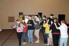 Snakes - A game that challenges teams to use non verbal communication to complete a team building activity.