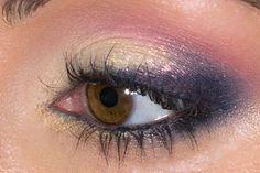Gold eye with smoky cat eyeliner