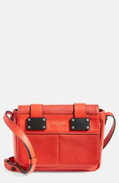 Lavishly textured, color-saturated leather ups the ante on an attention-grabbing crossbody bag, while industrial-inspired hardware provides a street-smart finishing touch.  The pop of color is the perfect contrast to the CAbi French Navy Jumpsuit.  http://www.cabionline.com/collection/clothes/french-navy-jumpsuit/