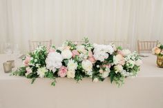 Top Table Floral Arrangement - Lucy Davenport Photography | English Country Garden Marquee Wedding | Essense Wedding Dress | Pink Multiway Bridesmaid Dresses