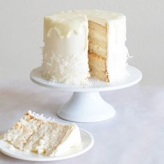 This Sky High Raffaello Cake consists of layers of coconut-almond cake, coconut buttercream and is topped with white chocolate ganache.